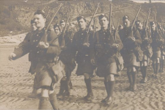World War I hero Sergeant John Lumsden, from Cupar  leading follow Black Watch soldiers in a march.