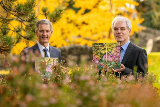 Dr Mark McGilchrist, Chair, Friends of the University Botanic Garden and Professor David Maguire, Interim Principal of the University, with one of the first printed copies of the book.