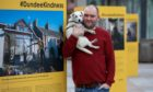 David P Scott with his dog Milli and the exhibition.