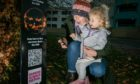 Mafalda Johnson and her daughter Milne, 3,  check out one of the QR codes on the trail across Dundee.