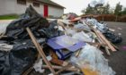 Rubbish dumped beside Davie Park in Rattray