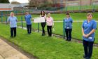 Kerri Graham and proud grandmother Anna Graham are pictured handing over a £2000 cheque to PRI nurses and care staff Lynn Thomson, Susan Thomson, Trish Irvine and Lorraine Herbert in memory of Big County businessman Jim Graham.