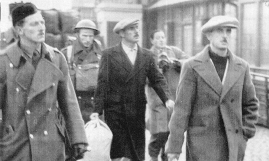 Italian Navy prisoners of war coming ashore in Scotland in the 1940s.
