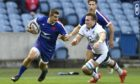 France's Thomas Ramos tries to escape Matt Fagerson at Murrayfield.
