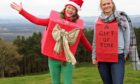 Anya Hart Dyke and her friend Ruth Nicolle promoting The Gift of Time idea by climbing Hill of Tarvit.