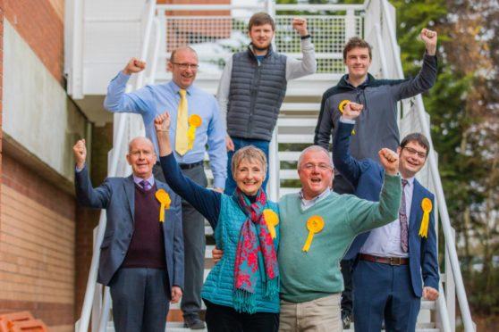 Local Liberal Democrats celebrated Liz Barrett's victory.
