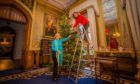 Lady Mansfield and daughter Louisa Murray putting up Christmas decorations at Scone Palace.