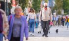 People wearing masks on the streets of Perth during the coronavirus pandemic.