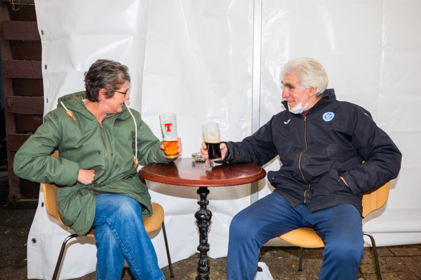 Doris Dickson and Bruce McAlpine enjoy a drink at The Malt House
