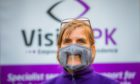 Gill Sutherland (of VisionPK) wearing one of the masks