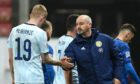 Steve Clarke and Oli McBurnie shake hands after the final whistle in Slovakia.