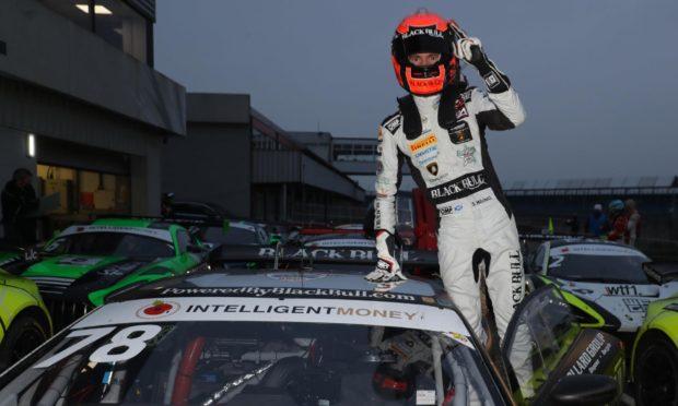 2020 British GT Champion Sandy Mitchell celebrates at Silverstone.