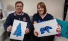 Julie Martin-Davy and her husband Mark with the designs chosen by the charity.