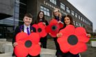 Levenmouth Academy pupils Bethan Smart, Zoe Campbell, Ella McLean, and Leah Thomson with some of the poppies.