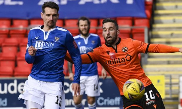 Craig Bryson battles for the ball with Nicky Clark.