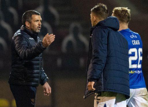 Callum Davidson congratulates his players at Motherwell.