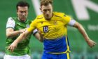 Liam Craig and Stevie Mallan battle for possession.