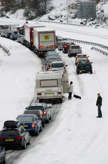 Freak lightning storms and the worst November snow for more than 17 years brought chaos to Courier country over the weekend. Pictured; People and vehicles stranded on the M90 south of Perth after a lorry jack-knifed.