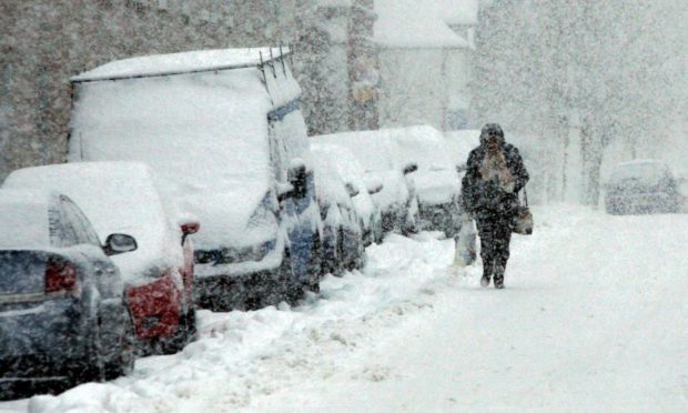 A woman struggling home from the shops in Stanley during the 2010 winter.