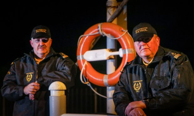 William Brown and Gareth Norman with one of the newly-replaced life rings at Broughty Ferry Harbour.