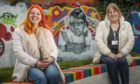 Brooke Reid (left) at the mural of her daughter, Freya Skene, with toy recycle organiser Lucie Conway.