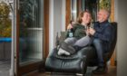 Denis Monks and Carmin Dow relax at the luxury lodge just two fields away from their home.