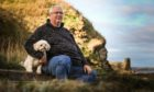 Ian Barnett at the harbour with his dog Betty.