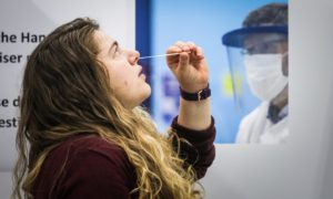 St Andrews University student Sophie Tyler takes a test whilst being instructed on how to do it by Professor Terry Smith.
