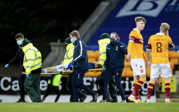 Murray Davidson is stretchered off.