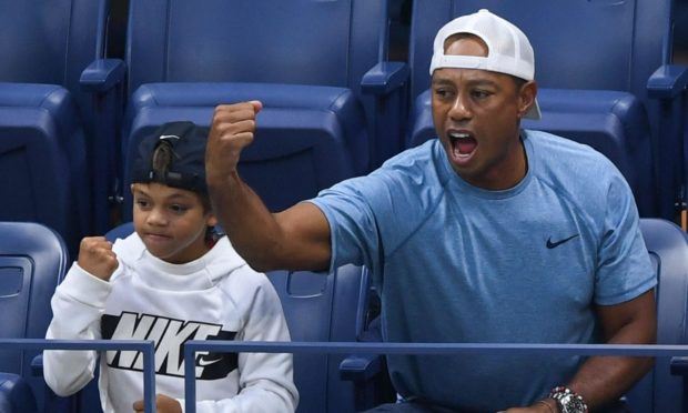 Tiger Woods with Charlie watching the US Open tennis last year.