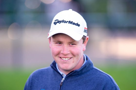 Scotland's Robert MacIntyre had a shot at the Race to Dubai title going into the final day of the season.