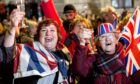 Brexiteers celebrate as they attend a gathering on Parliament Square in central London in celebration of the official moment the United Kingdom left the EU (January 2020).