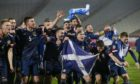 Mandatory Credit: Photo by ANDREJ CUKIC/EPA-EFE/Shutterstock (11013987ci) Scotland's players celebrate after winning the penalty shootout of the UEFA EURO 2020 qualification playoff match between Serbia and Scotland in Belgrade, Serbia, 12 November 2020. Serbia vs Scotland, Belgrade - 12 Nov 2020