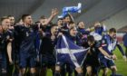 The Scotland team celebrates its win over Serbia and a place at Euro 2020.