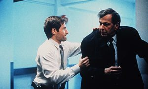 David Duchovny and William B Davis in a scene from The X-Files.