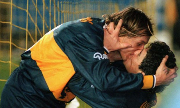 Claudio Caniggia and Diego Maradona celebrate a goal during their time together at Boca Juniors.