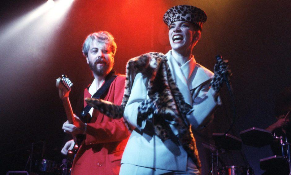 Dave Stewart and Annie Lennox on stage.