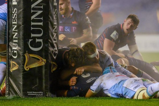 Prop Lee-Roy Atalifo goes over for Edinburgh's first-half try.