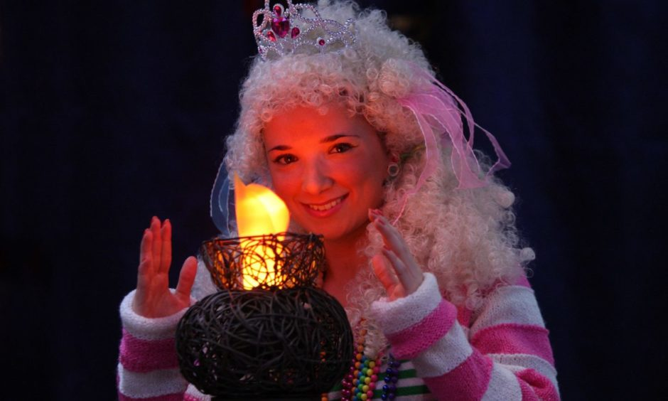 Perth Theatre. Dress rehearsal for Aladdin. Pictured, 'Princess Pikaboo' , played by Katy Wale, looked to be keeping warm during this cold spell, pictured here with a stage prop lantern.