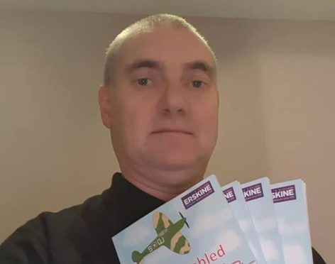 Brian with copies of his latest book.
