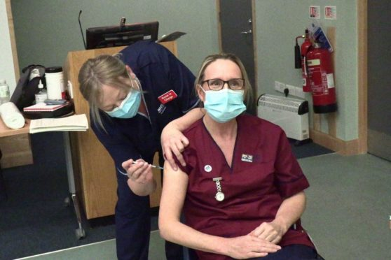 Marie was vaccinated earlier today by colleague, Candice Ross, at the Victoria Hospital in Kirkcaldy.