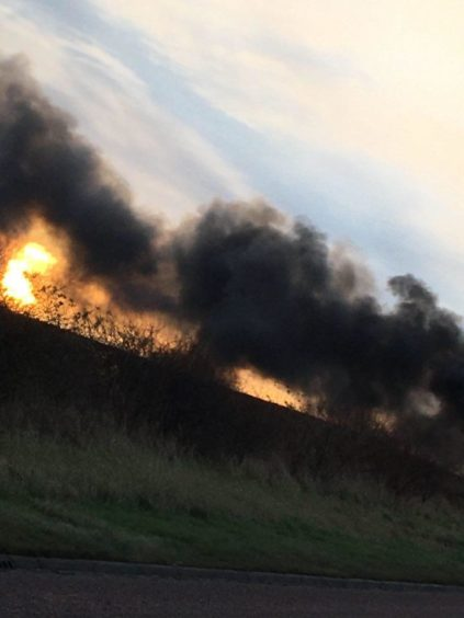 A huge plume of smoke in the air during the A92 bus blaze.
