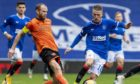 Dundee United captain Mark Reynolds in action against Rangers.