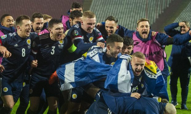 BELGRADE, SERBIA - NOVEMBER 12: Scotland's players celebrate after David Marshall saves Aleksandar Mitrovic's celebration during the UEFA Euro 2020 Qualifier between Serbia and Scotland at the Stadion Rajko Mitic on November 12, 2020, in Belgrade, Serbia. (Photo by Nikola Krstic / SNS Group)