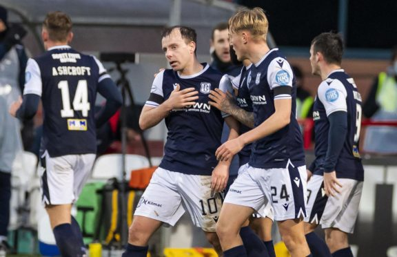 Dundee's Paul McGowan (centre) celebrates his winning goal against Arbroath.