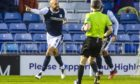 Dundee's Liam Fontaine celebrates in front of the home fans as he makes it 1-0.