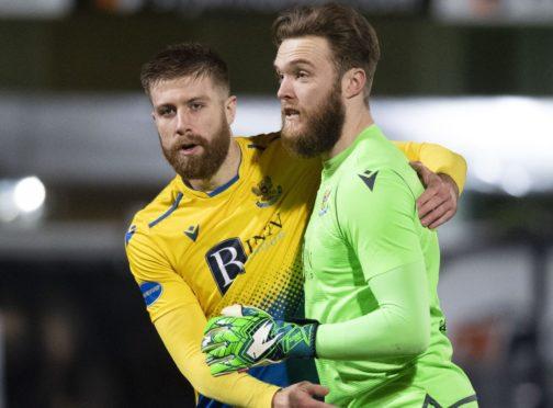 Shaun Rooney and Zander Clark celebrate Saints getting to the semi-final.