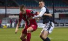 Dunfermline's Lewis Mayo (left) holds off Jordan Marshall during a Scottish Championship match between Dundee and Dunfermline at the Kilmac Stadium at Dens Park, on December 19, 2020.