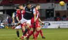 Dundee's Osman Sow scores to make it 2-0 against Dunfermline.
