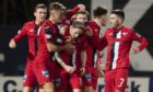 Dunfermline striker Declan McManus (centre) is mobbed by team-mates after netting the equaliser at Dens Park.